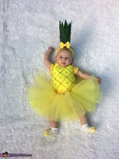 Hope: For my daughter Rowan Michelle Harmer's first Halloween I DIYed her pineapple costume. A onesie dyed yellow with felt squares and rhinestones plus a tutu made out of yellow glitter...