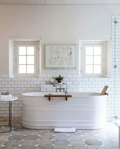 Guest bathroom????   Watering trough painted white. Perfect!
