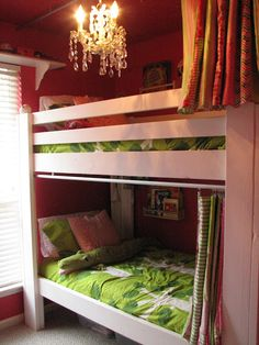 Bunk beds with curtains and book shelves for each bunk
