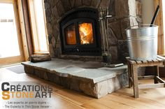 Fireplace done with Tudor Old Country Fieldstone from Cultured Stone. Natural flagstone for Hearth.