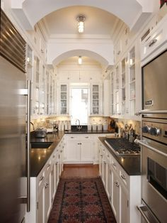 Galley kitchen in white and stainless steel