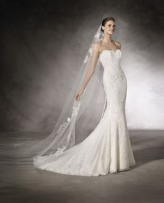 """Meet """"Kiara"""" by Pronovias of Barcelona.  She has a beautiful sweetheart strapless neckline and features double-layered lace throughout the entire dress.  The silhouette is a subtle fit-and-flare the finishes in a scalloped-edge court-length train.  wedding dress / bridal gown new braunfels, san antonio, austin"""