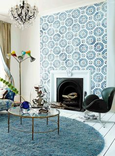 blue and white tiled fireplace becomes the focal point of the living room.