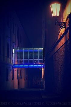 bridge illuminated between two buildings......