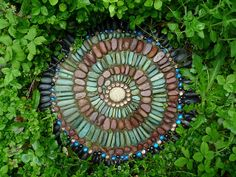 Round step stone with marbles, Indonesian Turquoise, Red Montana Rainbow, Black Mexican Beach and center beach stone   Art Blog: Jeffrey Bale's Mosaic Pilgrimage, a labour of love, a labour of pebbles!