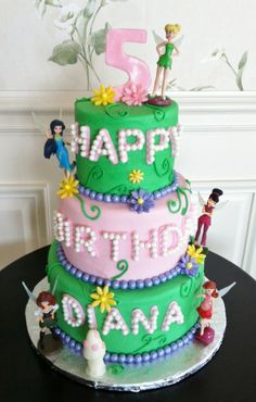 Birthday Cakes - Tinker Bell Fairies themed cake.  Buttercream iced tiers, modeling chocolate flowers and number.
