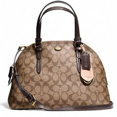 "Coach Peyton Signature Dome   NWT Authentic Coach Peyton Signature C Cora Dome Satchel. Beautiful brown and mahogany colors. Signature c canvas material with leather trim. Beautiful and classy . Dimensions: 12 1/2"" L, 9"" H, 5 1/2"" W, with 5 1/4"" strap drop and longer strap included for shoulder carry. Coach Bags"
