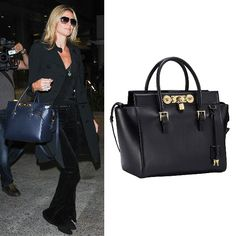 36b8e311c7 Heidi Klum was looking beyond chic wearing a black trench coat and carrying  the Versace blue Signature Lock bag at LAX.