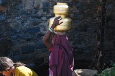 Indian woman carrying water to her village.
