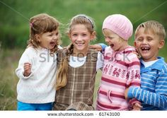 Group of kids laughing.
