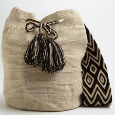 Handcrafted Cabo Wayuu Mochila Bohemian bags are tightly woven by two strands of thread and intricate in their designs, taking days to weave. The braided strap has its own unique design and deta Tapestry Bag, Tapestry Crochet, Crochet Handbags, Crochet Purses, Love Crochet, Knit Crochet, Crochet Tote, Mochila Crochet, Diy Mode