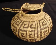 Native American basket with a simple geometric design, lid, and braided handle probably from the Southwest and/or Great Basin area (possibly Pima). It is constructed of non-interlocking stitches, closed spacing; knotted coiled start, and a self coiled rim finish. The attention to detail is incredible. It is very well made and in great condition. Circa early 1900s.    Measures 5 1/4 inches high and 6 1/2 inches in diameter.