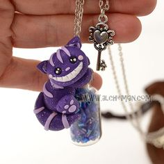 Cheshire Cat Necklace by www.alchemian.com #handmade #necklace #Alice #stregatto #woderland #pclay #polymer #clay #Cheshire #handmade #alchemian