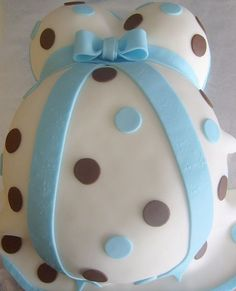 baby belly cakes for baby shower | White pregnant body baby shower cake with light blue ribbon and ...