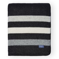 Simple stripes of heather grey add elegant detail to this black Merino wool throw.