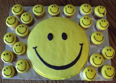 Smiley face cake and matching cupcakes.