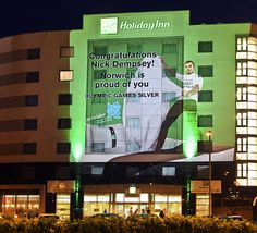 Britain's Nick Dempsey has been given a special welcome home in his hometown of Norwich by hotel chain Holiday Inn projecting him onto the side of their building surfing with a bed-sheet.