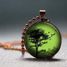 SALE Copper Emerald Sunset Tree Domed Resin Pendant C166-1CM. $8.50, via Etsy.