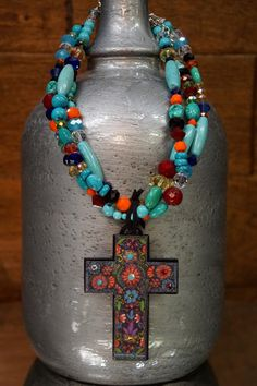 This is one gorgeous piece of jewelry. It is a three strand multi colored beaded…