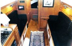This is the most amazing renovation of a sailboat cabin that I've ever seen. This is a Catalina 27 - at her longest, she's 27' and at her widest she's 8'... outside dimensions. We're not talking a ton of space here, but this is cozy, inviting, and it works.