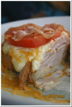 The Kentucky Hot Brown. I'm a sucker for a good ole' sloppy open faced sandwich. This one has a big pile of turkey, bacon, tomato and cheese sauce. Great way to use leftover turkey. My tummy wants this.