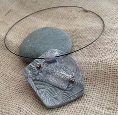 Back side-double function pendant