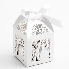 The elegant White Filigree Bride and Groom Favour Boxes are perfect for decorating your wedding tables as well as housing pretty wedding favours for your guests. Featuring a laser cut Bride and Groom design, these boxes are perfect for traditional weddings.