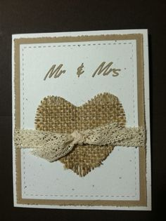 Burlap heart on speckled white using Lil Inkers stitched squares layered on distressed kraft paper. White speckled card base. Stampin Up ribbon & Mr & Mrs cut on Silhouette.