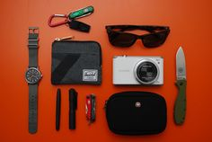 Timex Weekender / Victorinox Swiss Army Signature Lite / Acme Tornado 636 Whistle / Herschel Supply Co. Johnny Wallet / Fisher Bullet Space Pen / Streamlight Microstream Flashlight / Gerber Dime Multitool / Polaroid Eyewear P8243/S / Samsung WB350F Camera / Wenger Swiss Gear Legacy Camera Case / ESEE Zancudo