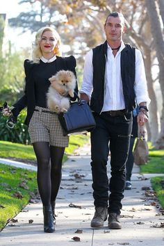 Gwen Stefani wore a black jacket and jumper with tweed shorts and boots to attend a Thanksgiving celebration with husband Gavin Rossdale and her pet Pomeranian.
