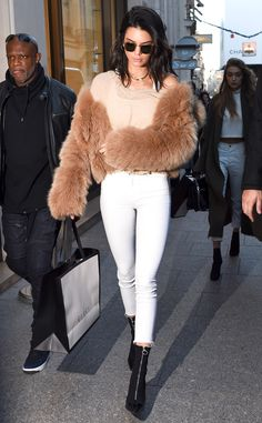 Kendall Jenner from The Big Picture: Today's Hot Pics  Peachy in Paris! The model rocks a peach hued fur while shopping at Gucci surrounded by security in Paris, France.