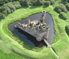 Caerlaverock Castle, Scotland  c. 1277   a triangular shape castle in southern Scotland with a tower at each corner