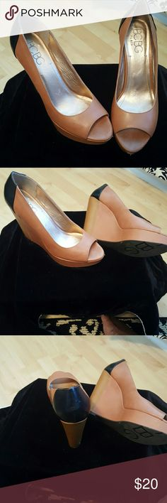 Shoes Wedged Heeled Two-toned Very cute Shoe. Platformed front helps to keep you balanced BCBG Shoes Wedges