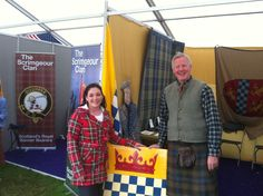 Girl in Royal Stewart coat at Stewart Society Stand at Bannockburn 2014 with Lachlan Stewart Society President