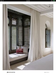 Window seat. Love the long curtains and bigger window seat, seems like such a cozy place for an afternoon nap!