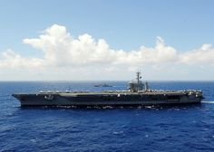 USS Nimitz is alongside the Republic of Singapore frigate RSS Formidable. by Official U.S. Navy Imagery, via Flickr