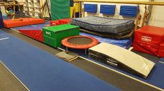 "Preschool Gymnastics: September 2015 Week 3 ""Day with Dinosaurs!"" 1. Run up gray board, dinosaur stomp (jump) on trampoline, and land in pencil shape on block. 2. Forward roll like a dino egg down the cheese."