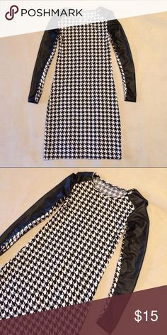 Body con hounds tooth dress Faux leather detailing on sleeves--feels a little weird in armpits because the dress was taken-in in the sleeves and sides, but can't really tell visually--hits mid thigh, unlined😎 Dresses Mini