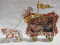Wonderful little circus wagon made from an altoid tin, I think.