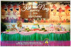 Kai Ning's Hello Kitty (Hawaiian Style) Birthday Party!  Great set up by www.birthdaycastle.com.my of the whole venue, main table/dessert table, backdrop, photo booth, Hawaiian skirt and leis, cake, party packs, games, balloons, door gifts, etc..  Love the theme and design!!