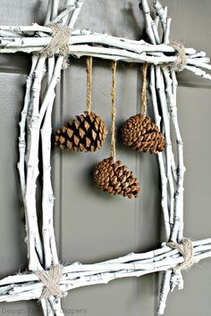 Create a #rustic yet modern winter #wreath by using twigs and pine cones from the yard and a little spray paint. The wreath can easily be altered to fit any hol…