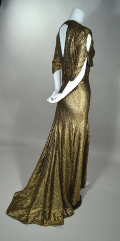 Late 1930's metallic gold silk lame bias cut Art Deco evening gown.