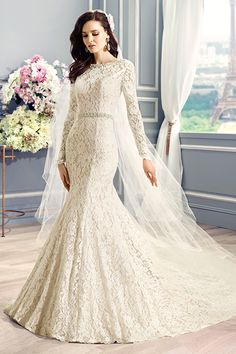 Classic lacy wedding gown by Moonlight Couture.  I'm a Queen and this dress is gorgeous!
