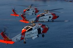Coast Guard MH-60 Jayhawk helicopters flying in formation