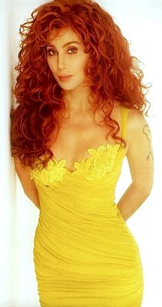 cher- c.1992 Ritmo de Perla, Italy. worn in photoshoots. has an internal bra, and is extremely tight (bandage) like a Herve Leger fit. straps can be twisted to be thinner. Bright lighting and editing made it yellower in photos