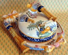 Quimper covered cheese dish in the biniou (bagpipe) form. Let them eat cheese!