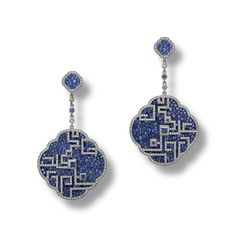 CARNET. A PAIR OF SAPPHIRE AND DIAMOND 'AZURE LATTICE' EARRINGS Each designed as a pavé-set sapphire pendant embellished with a lattice motif overlay, embellished with three square-shaped table-cut stones, suspended from a similarly-set surmount and spectical-set connecting chain set with a blue sapphire and two rose-cut diamonds, mounted in white gold and titanium, signed Carnet.