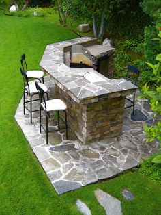 Outdoor bar and cooking station constructed out of stone