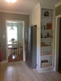 My Built in bookcase around refridgerator. I love it!