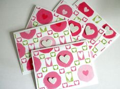 This is a set of note cards made from white cardstock and pink and green heart print cardstock.  The hearts are pretty, soft pastels.  I used two white glitter heart stickers on each one for embellish